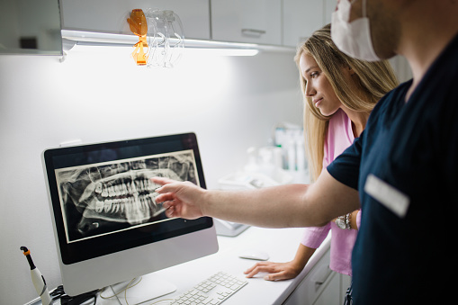 Doctor from Downey Oral and Maxillofacial Surgery looking at digital x-ray in Downey, CA